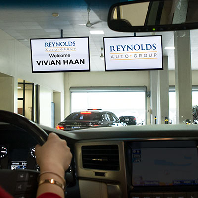 Customer seeing their name displayed on screen in the service department