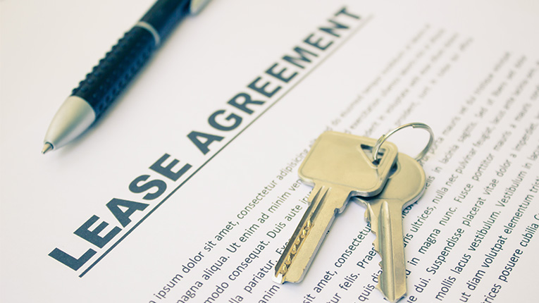 Keys on top of a lease agreement.
