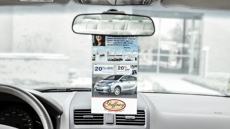 PromoTAG hanging on a rear-view mirror.